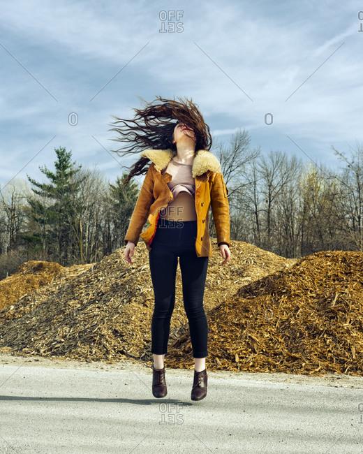 Full length of a brunette woman jumping