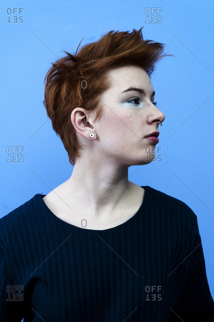 Studio shot of a redhead girl with piercings