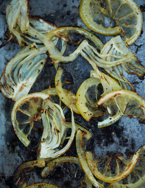 Onions and lemon rinds on a tray