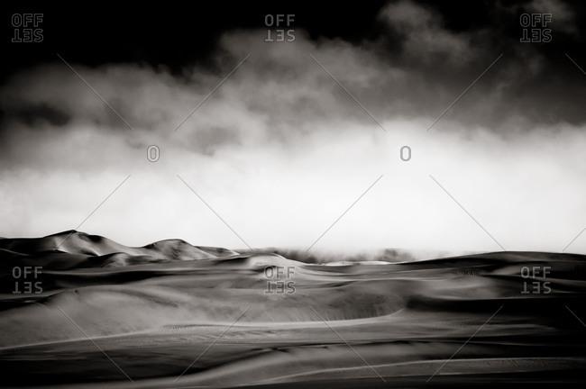 Fog rolling over Namib Desert