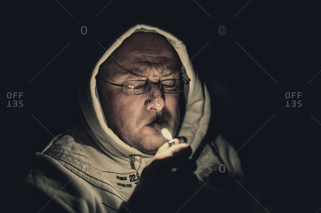 Smoker with lighter at night