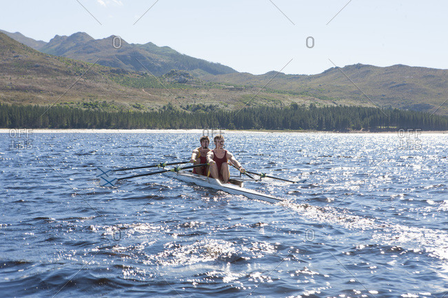 Double scull rowing boat in water