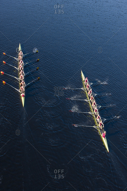 Overhead view of two rowing eights in water