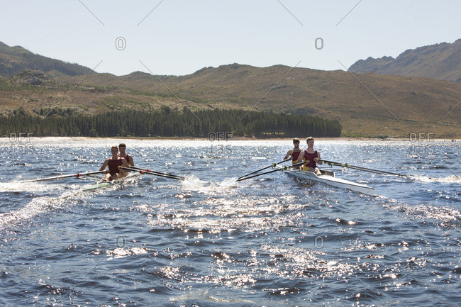 Two double scull rowing boats in water