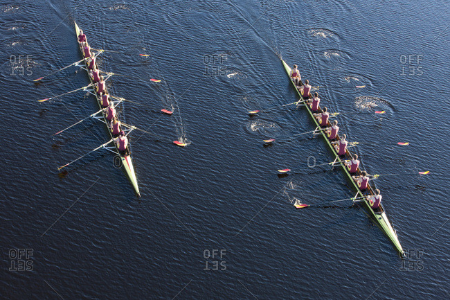Above view of two rowing eights in water