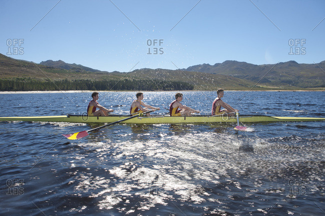 Profile of a coxless four rowing boat in water