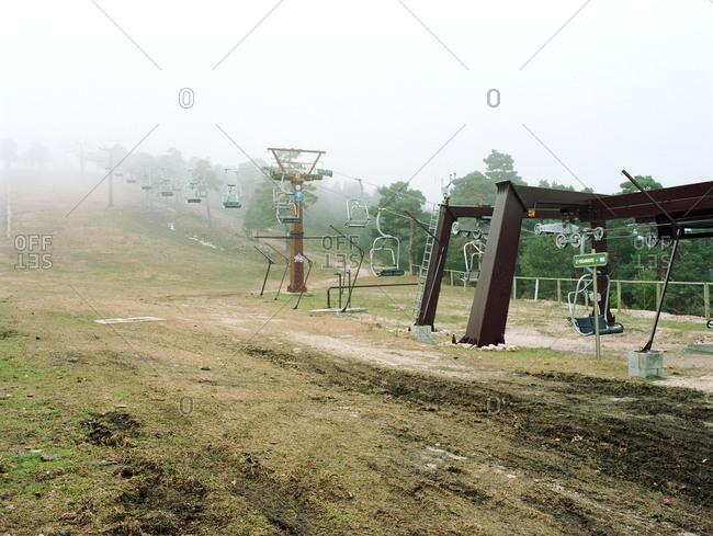 Base of chair lift at ski resort in the off season, Navacerrada, Spain