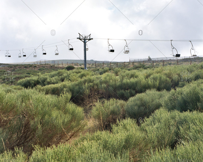 Chair lift over scrubland at ski resort in off season, Valdesqui, Spain