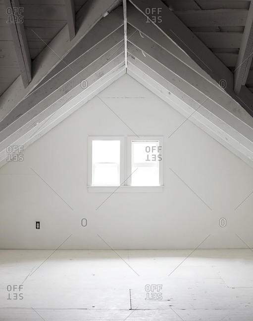 Windows in an empty attic room