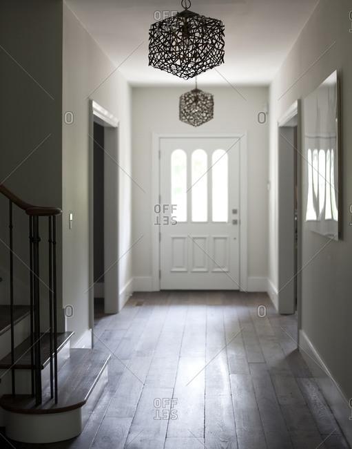 Empty hallway with modern light fixtures