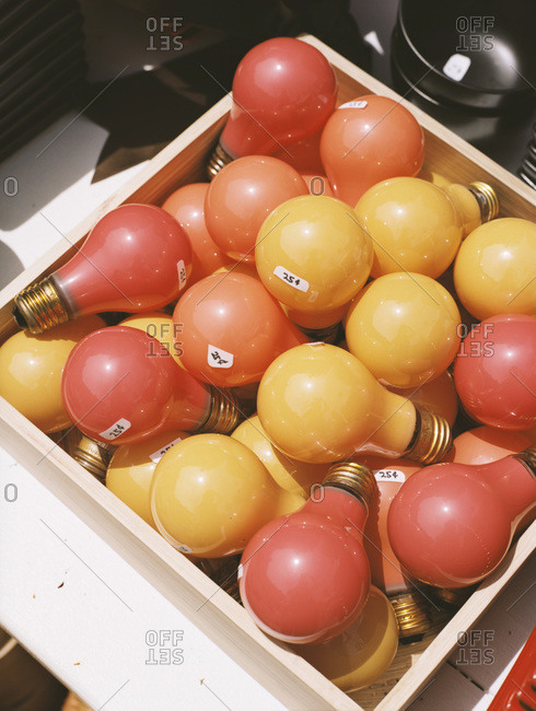 A box of colored incandescent light bulbs