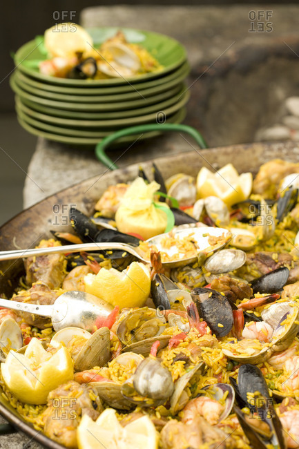 Paella and plates on fire pit