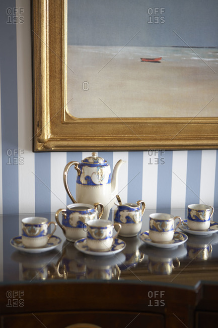 Formal tea set on cabinet