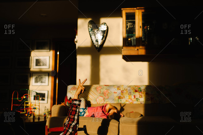 A boy makes shadow puppets
