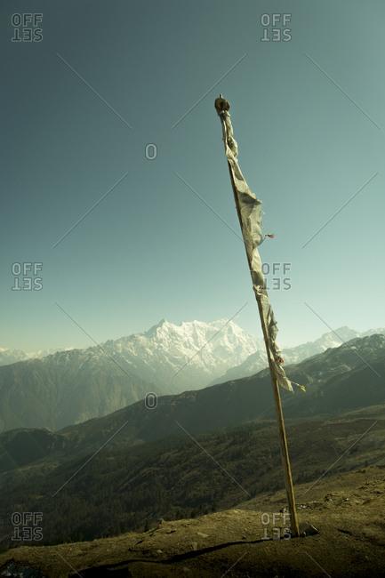 A prayer flag overlooks the Langtang Region of Nepal\'s Himalayan Mountain Range