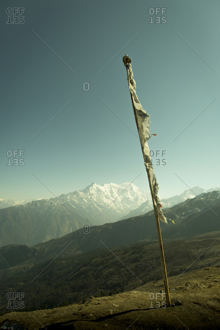 A prayer flag overlooks the Langtang Region of Nepal's Himalayan Mountain Range