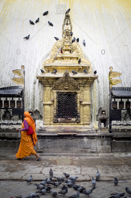 A woman in a sari circumambulates the Swayambu Temple in Kathmandu, Nepal