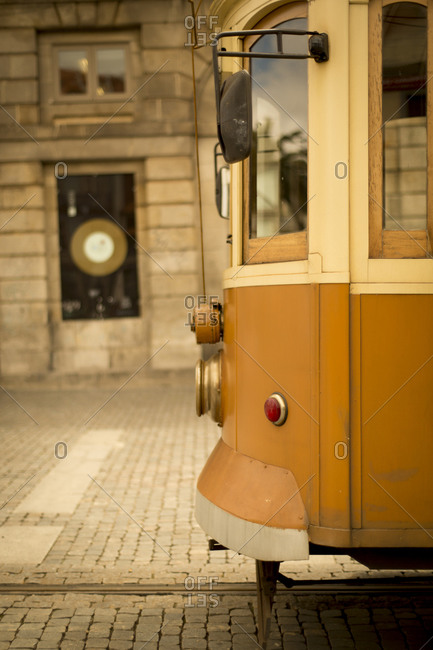 The old trolley of Porto waits for its riders in Portugal on a cobblestone street