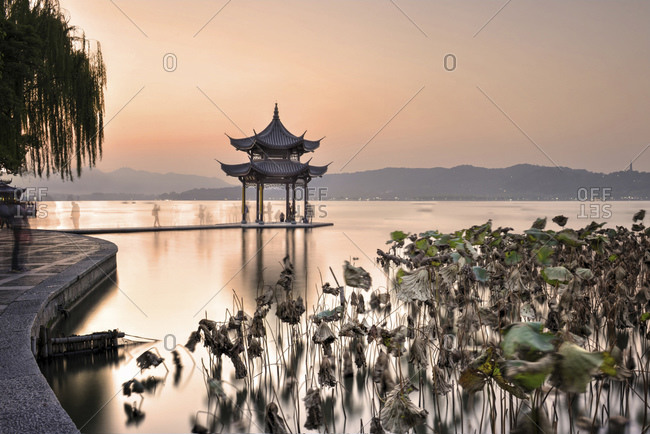 Pagoda at West Lake in Winter, with long exposure ghosting of visitors taking pictures