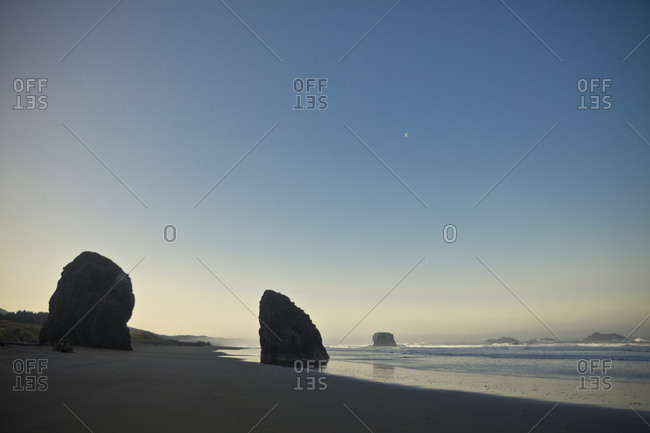 Two sea stacks line the shore at Pistol River State Park, Oregon