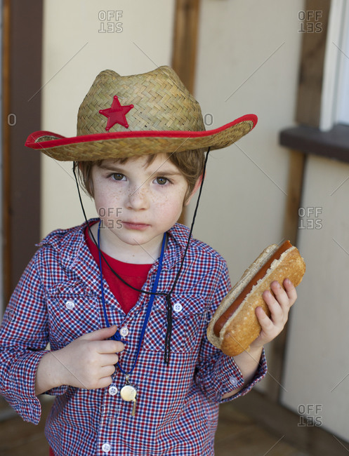 Young boy with hotdog
