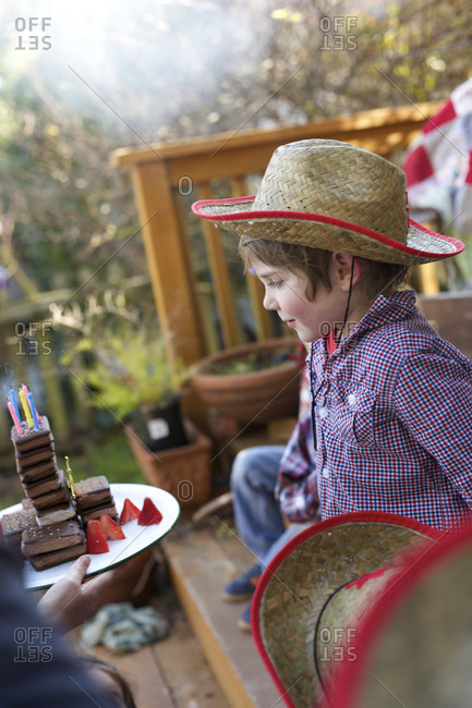 Young boy blowing out birthday candles