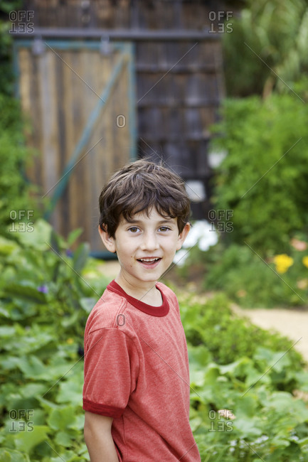 Young boy in garden