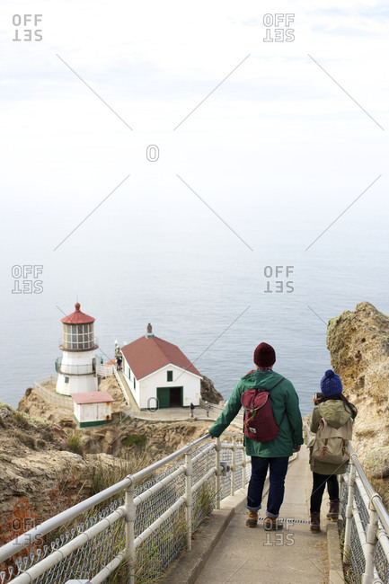 People look at a lighthouse