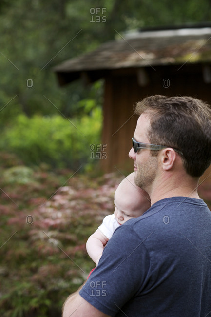 A father holds a baby