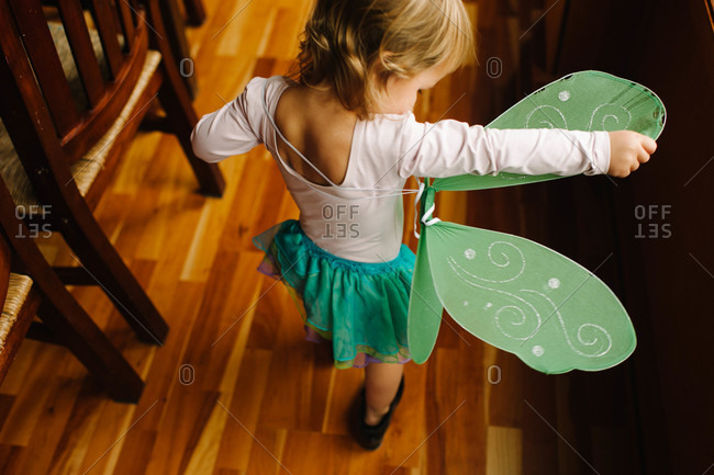 A young girl in fairy wings and tutu