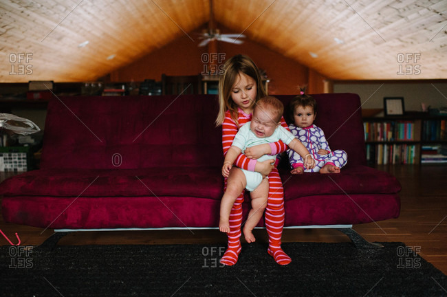 Children in a loft with crying baby