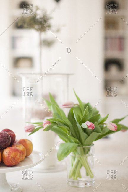 Still life of peaches with a bouquet of tulips