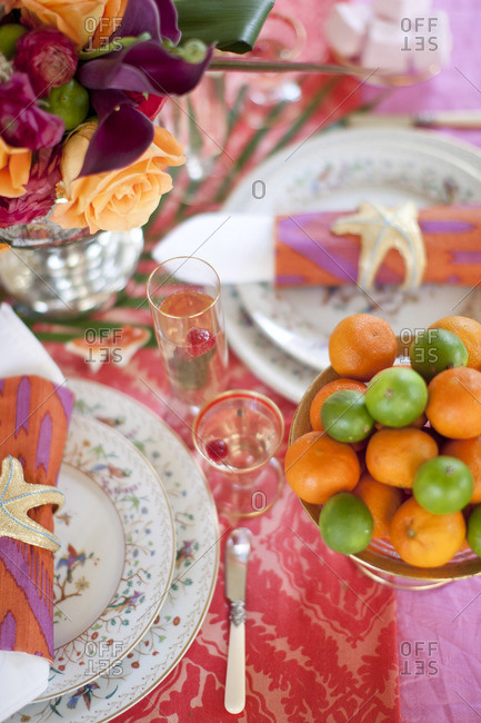 Set table with decoration and tangerines