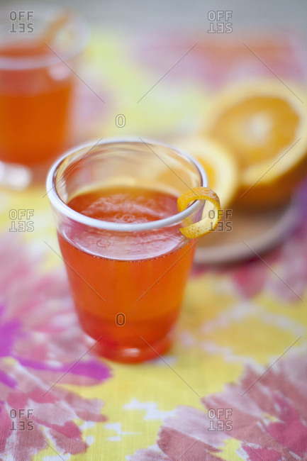 Glasses of orange juice on table