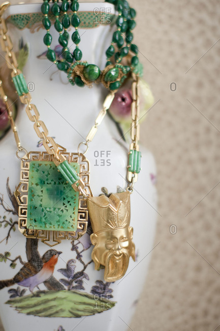 Jewelry hanging from vase