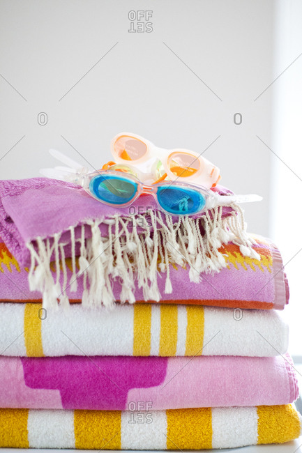 Goggles on stack of towels