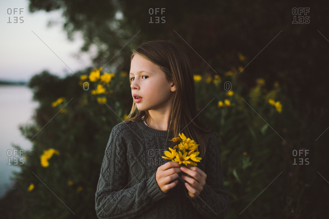 Profile of a girl with yellow flowers
