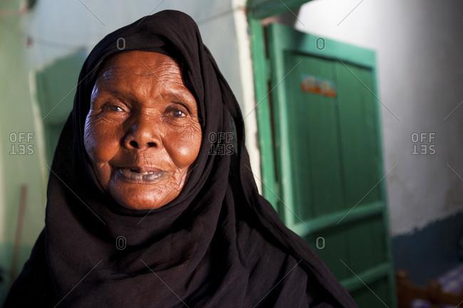 Aswan, Egypt - May 1, 2011: Portrait of a Nubian woman outside