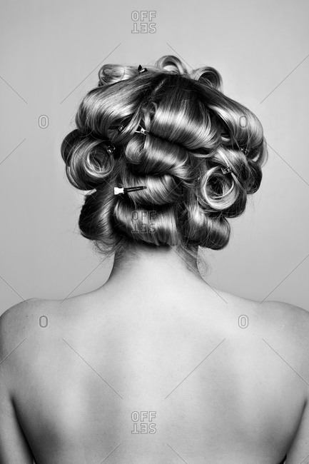 Back view of woman with clips in her hair