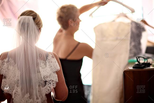 Bride dressing before wedding