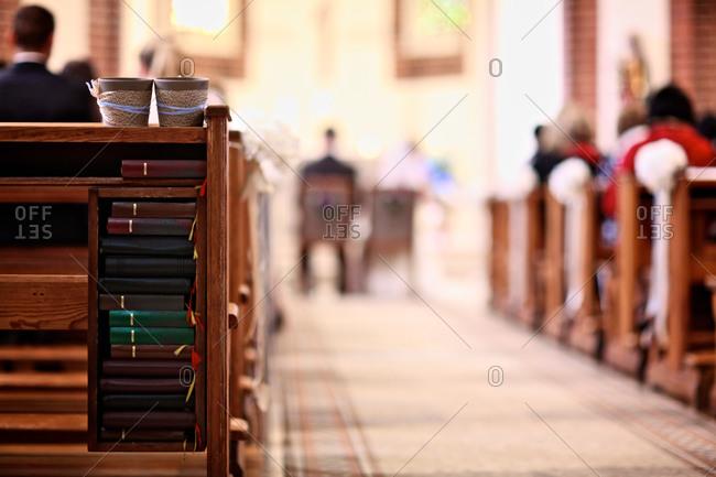 Aisle of church during wedding, short focus