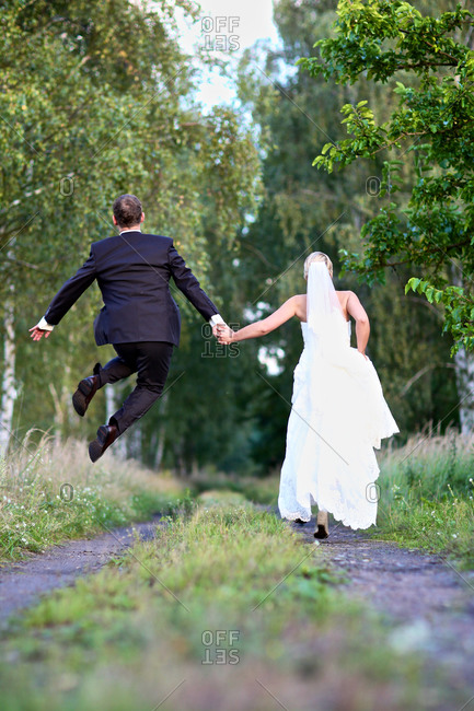 Newlywed couple frolicking after wedding
