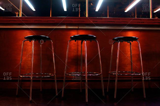 Three barstools at the bar