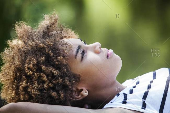 Close up of girl lying outdoors
