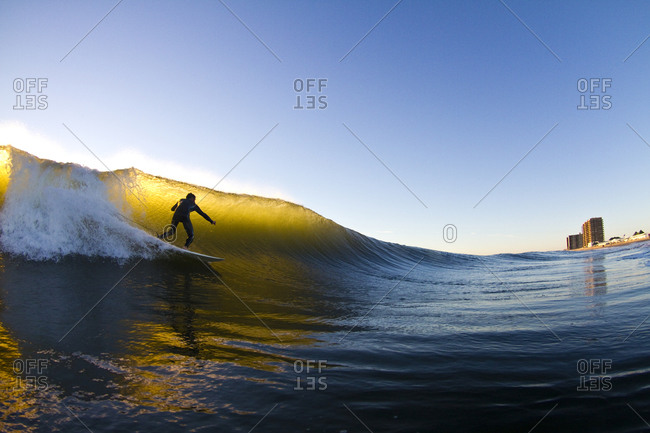 Surfer riding a wave - Offset