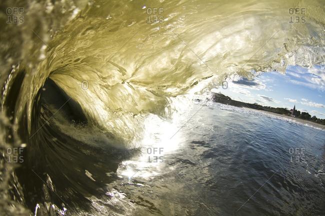 A wave breaking in sunlight