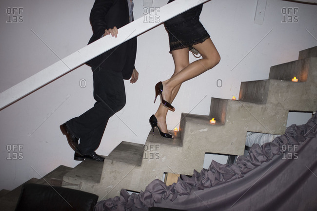 A woman and man walk up stairs