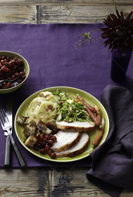 Sliced turkey served with Thanksgiving sides