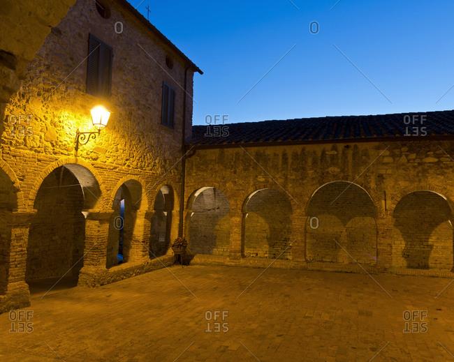 Old monastery at dusk in Suvereto, Italy