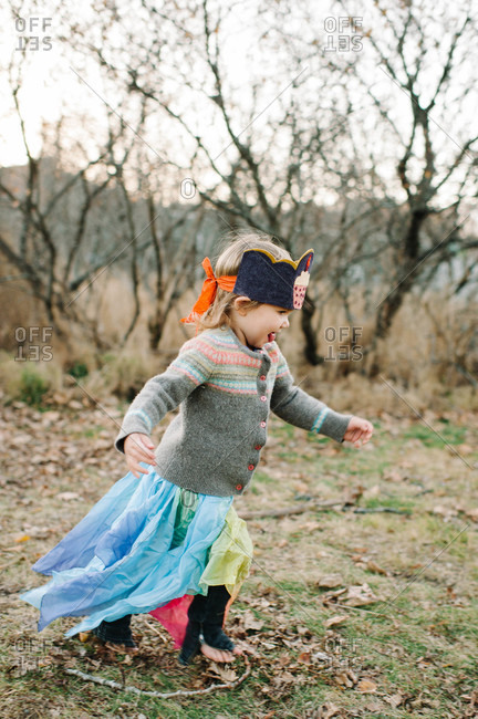 Young girl running in a costume